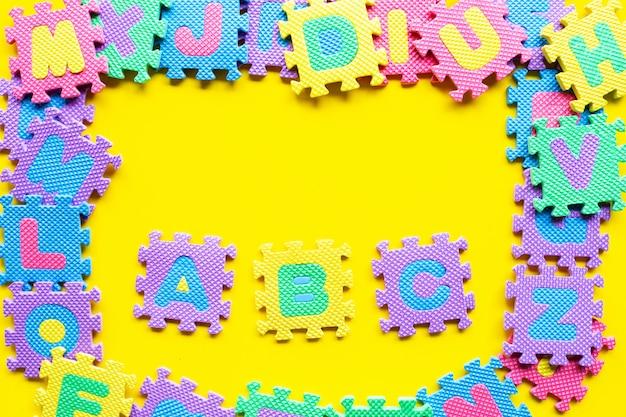 Alphabet puzzle on yellow