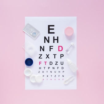 Alphabet table for optical consultation on pink background