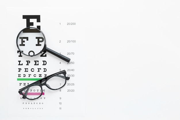 Alphabet table with magnifier and glasses