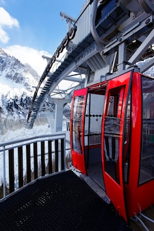 Alpine cable car in the mountains