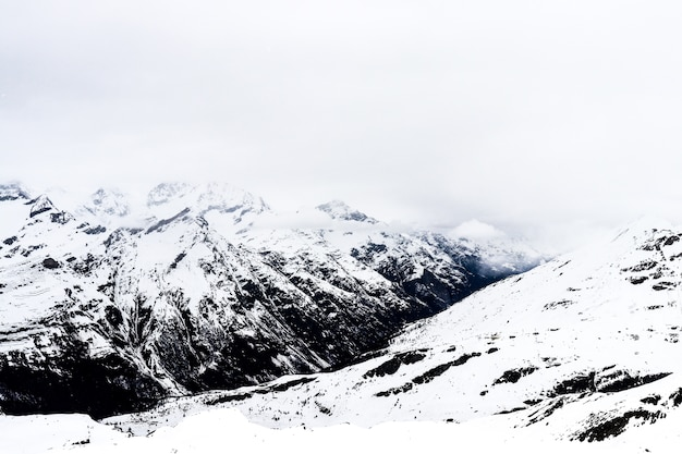 Alpine mountains in the cloudy day