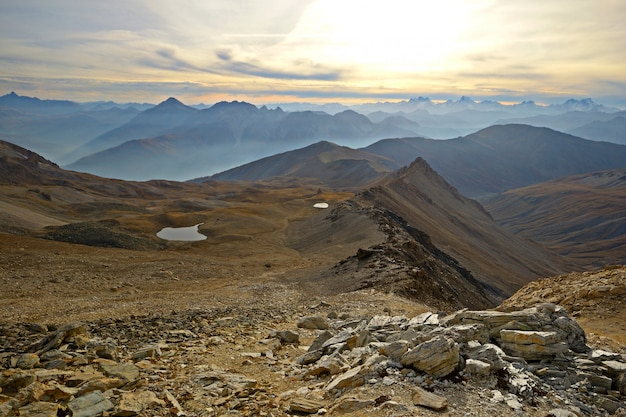 The alps in autumn, sunset from the summit of rocky mountain peaks and ridges