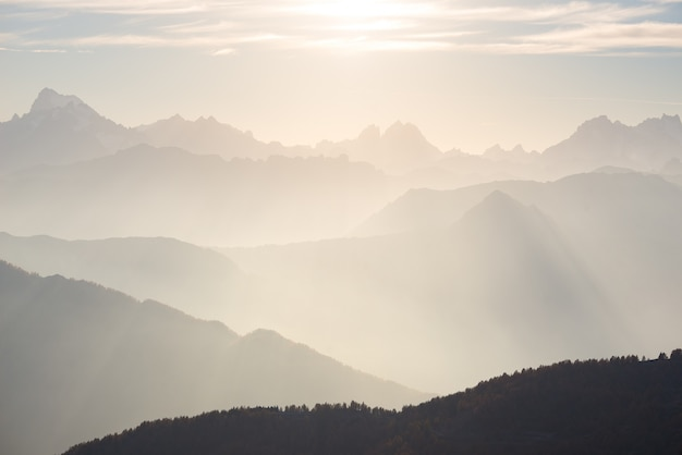 The alps in soft backlight. toned mountain range of the massif des ecrins national park, france.