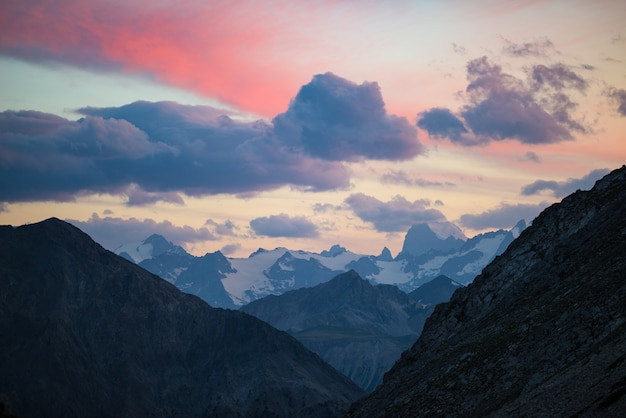 The alps at sunrise. colorful sky majestic peaks, dramatic valleys, rocky mountains. expansive view from above.