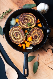 Alsace french local food meat stuffed in egg roll pasta in skillet iron pan