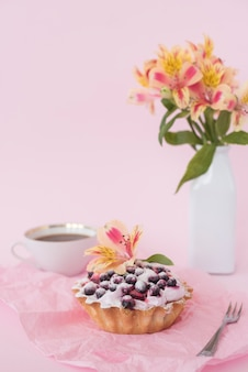 Alstroemeria flower on fruit tart consisting of blueberries