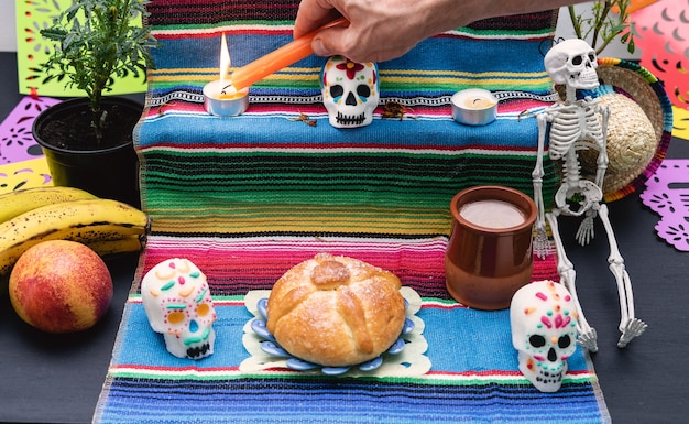 Altar decorated with pan de muerto and skulls. day of the dead. mexican holiday.