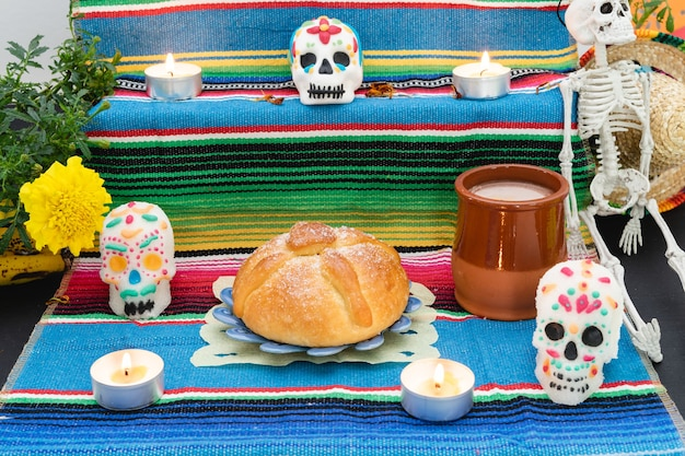 Altar decorated with pan de muerto and skulls day of the dead mexican holiday