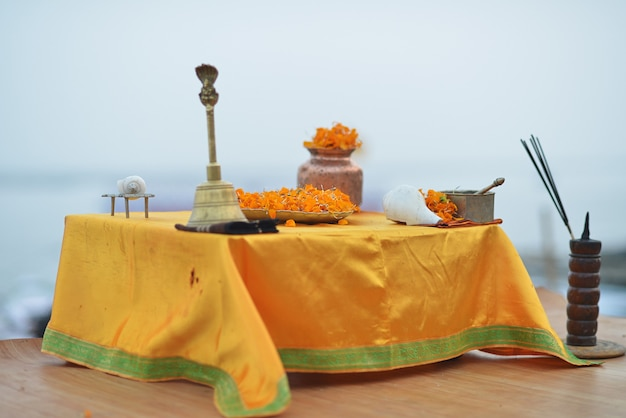 Altar in varanasi for your ganga aartida ceremony with flowers, conch, incense, every day at sunset