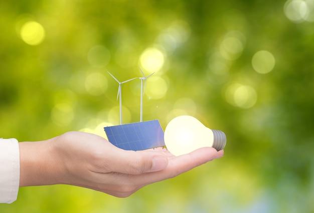 Концепция альтернативной энергии с 3d-рендерингом ветряных турбин, солнечных батарей и лампочек Premium Фотографии