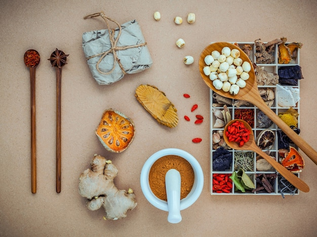 Alternative health care and herbal medicine.  dried various chinese herbs in wooden box.