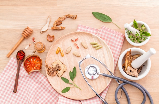 Alternative medicinal on wooden background.