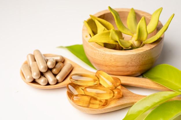 Alternative medicine herbal organic capsule with vitamin e omega 3 fish oil, mineral, drug with herbs leaf