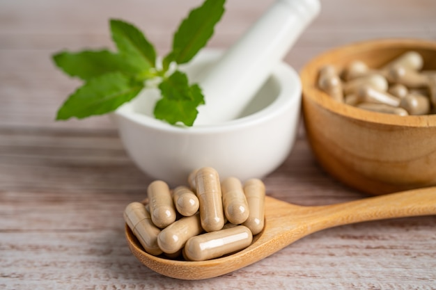 Alternative medicine nature herbal organic capsule, drug with herbs leaf natural supplements for healthy good life.