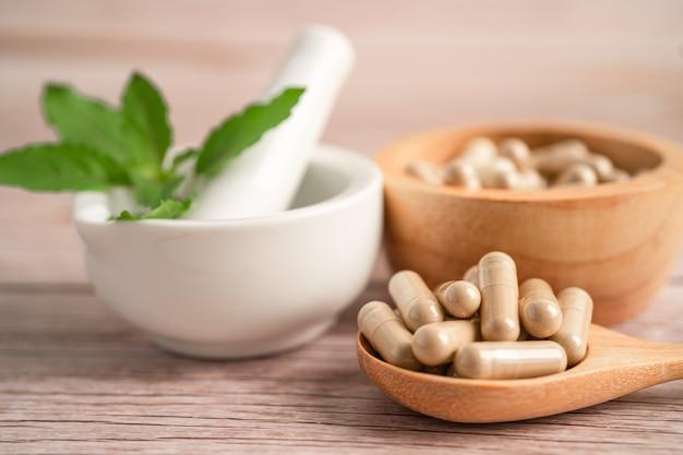 Alternative medicine nature herbal organic capsule drug with herbs leaf natural