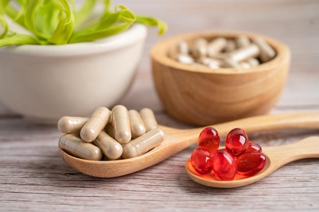 Alternative medicine nature herbal organic capsule drug with herbs leaf