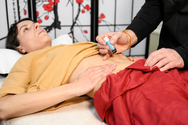 Alternative therapist applying moxibustion a traditional chinese medicine method.