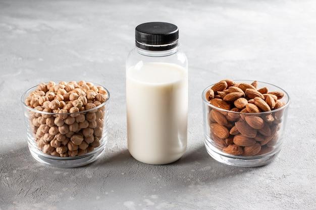 Alternative vegan milk in bottle on a concrete background