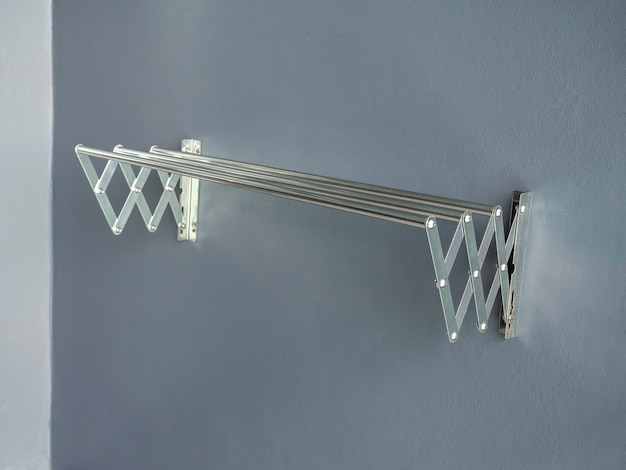 Aluminium folding clothes drying rack on the wall