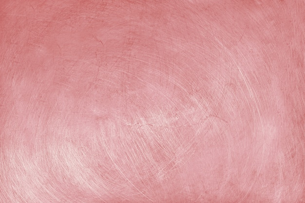Aluminium texture background with rose gold color, pattern of scratches on stainless steel.