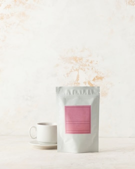 Aluminum bag for tea coffee with pink label for signature on a light background