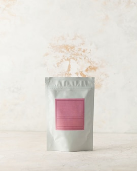 Aluminum bag for tea coffee with a pink label