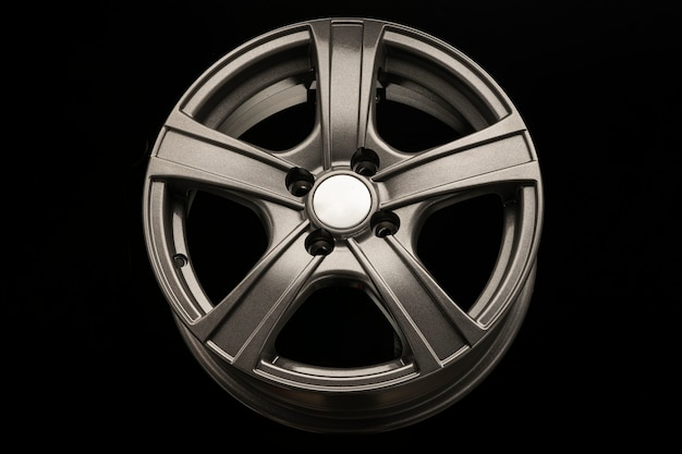 Aluminum gray alloy wheel on black background.