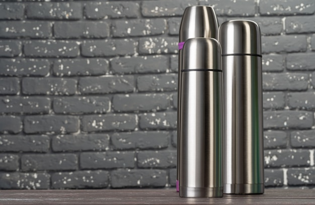 Aluminum metal thermos container bottle close up on table