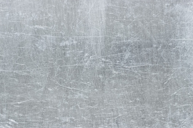 Aluminum plate as background, metal texture with scratches on the surface
