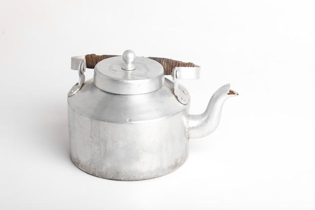 Aluminum tea kettle or tea pot on white surface