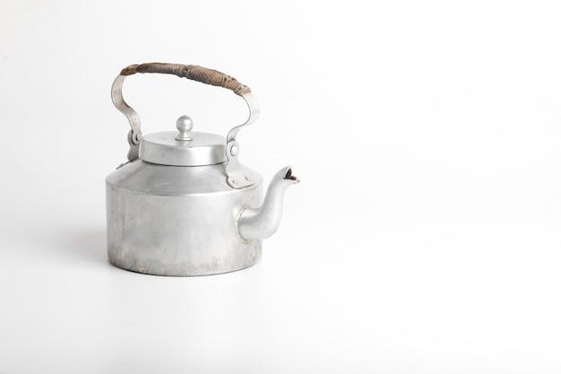 Aluminum tea kettle on white surface