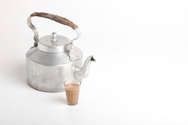 Aluminum tea pot with rusk on white surface