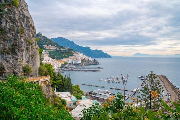 Amalfi cityscape on coast line of mediterranean sea, traveling in italy