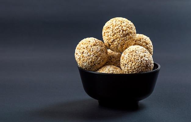 Amaranth or rajgira laddu, cholai ke laddo in black bowl on black background