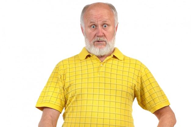 Amazed and astonished senior bald man