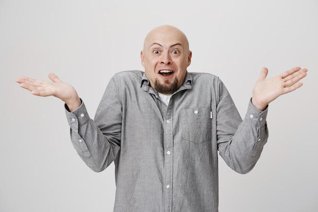 Amazed happy bald man look surprised