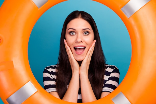 Amazed lady look orange emergency life buoy hands cheeks open mouth