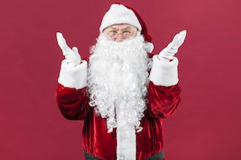 Amazed Santa Claus in glasses with hands up
