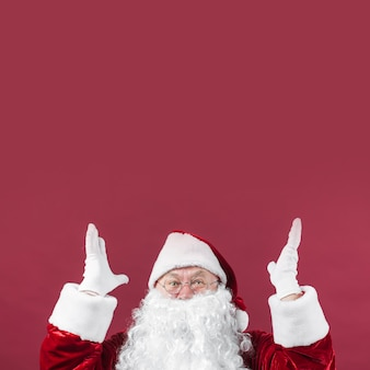 Amazed santa claus with hands up