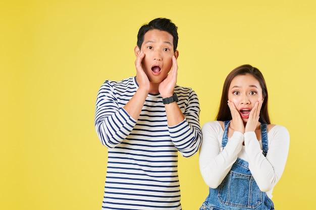 Amazed shocked young couple