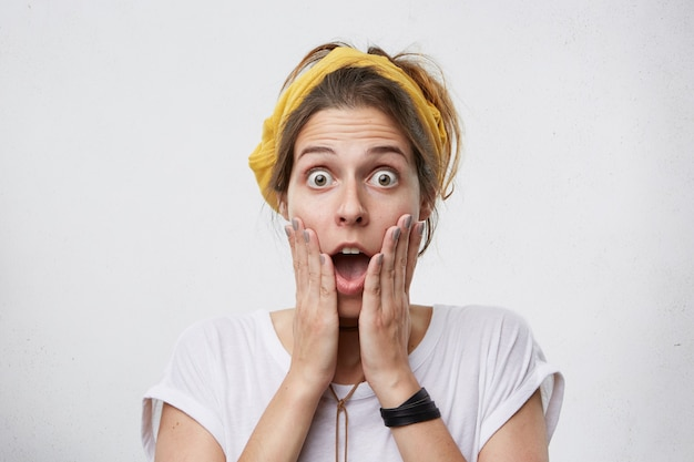 Amazed woman being shocked reaction.