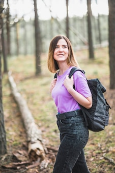 Amazed woman walking in forest