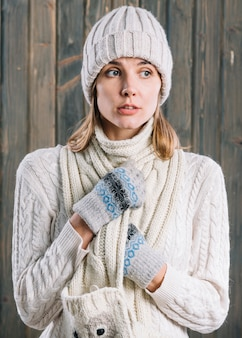 Amazed woman in white sweater