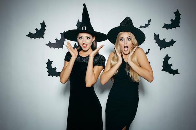 Amazed women on halloween party