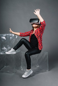 Amazed young woman touching the air during the vr experience