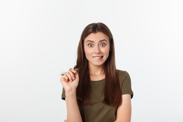 Amazement  woman excited looking to the side. surprised happy young woman looking sideways in excitement. mixed race asian and white caucasian female model on grey .