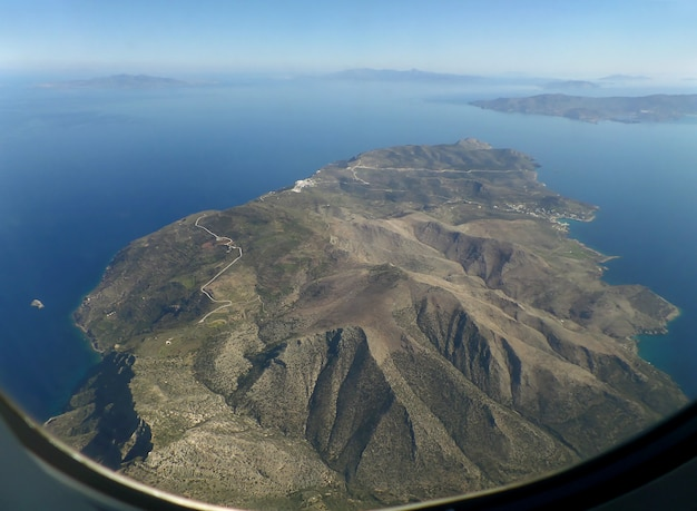 Amazing aerial view of santorini island as seen from plane window before landing, greece