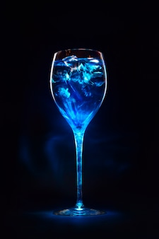 Amazing blue cocktail with ice cubes