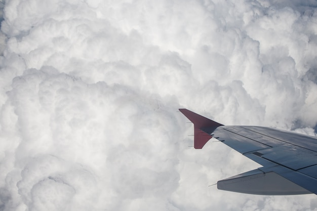 Amazing clouds and the sky as seen through the window of an aircraft.