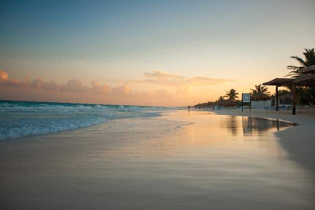 Amazing colorful sunset on the tropical beach in mexico